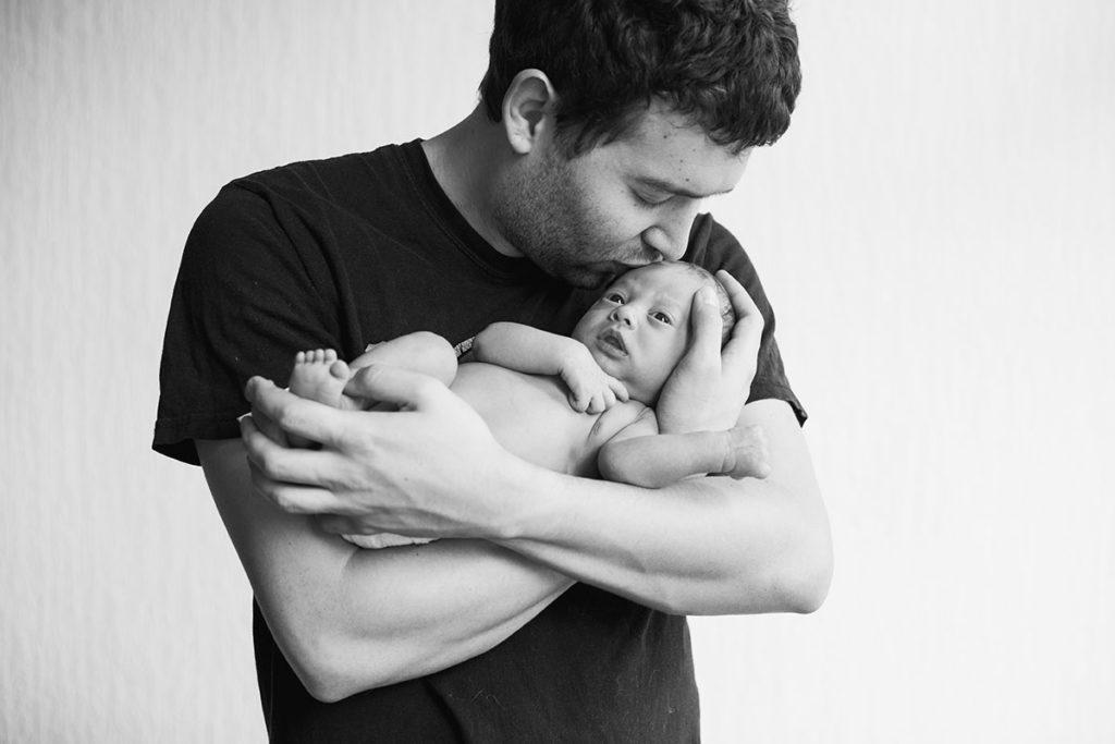 Sean Holding Newborn Toviy